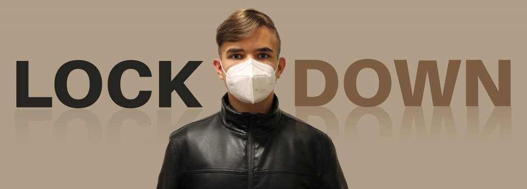 """Image of boy wearing mask in front of text saying """"Lock Down"""""""