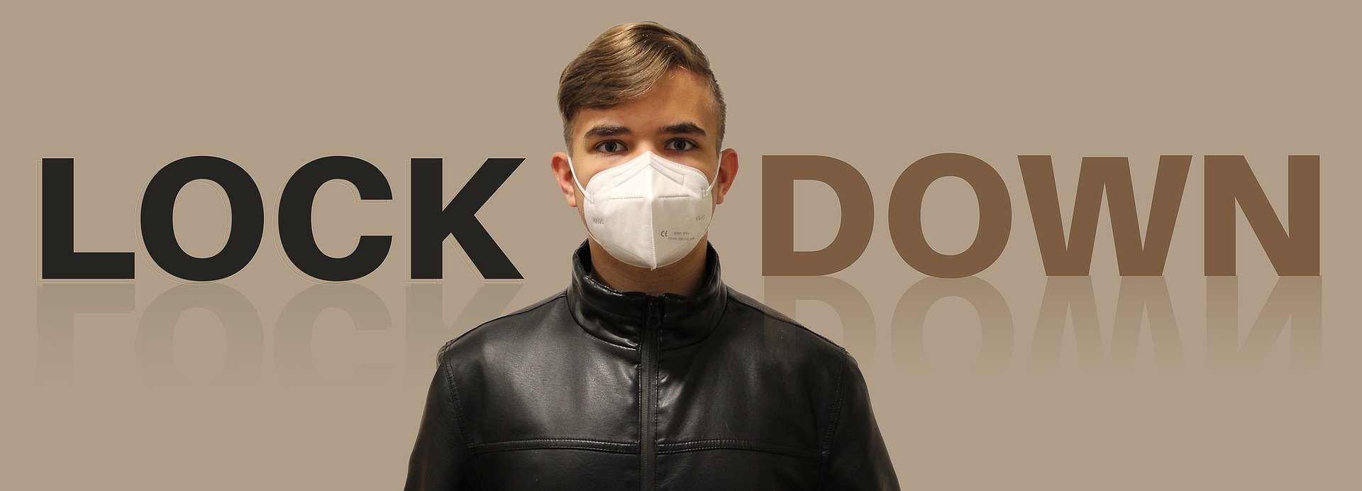 "Image of boy wearing mask in front of text saying ""Lock Down"""